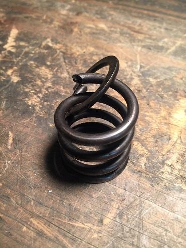 broken valve spring from Sportster motor