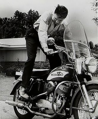 Elvis Presley kick-starting his Harley-Davidson Model K